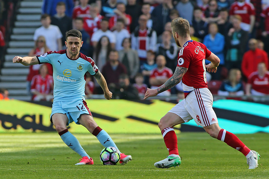 Burnley's Robbie Brady plays the ball away from Middlesbrough's Adam Clayton<br /> <br /> Photographer David Shipman/CameraSport<br /> <br /> The Premier League - Middlesbrough v Burnley - Saturday 8th April 2017 - Riverside Stadium - Middlesbrough<br /> <br /> World Copyright &copy; 2017 CameraSport. All rights reserved. 43 Linden Ave. Countesthorpe. Leicester. England. LE8 5PG - Tel: +44 (0) 116 277 4147 - admin@camerasport.com - www.camerasport.com