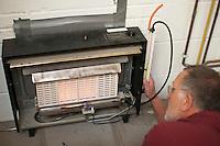 Student gas fitter testing gas pressure, Able Skills, Dartford, Kent.
