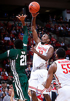 Ohio State Buckeyes forward Sam Thompson (12) puts up a shot over Ohio Bobcats forward Jon Smith (21) in the second half of the college basketball game between the Ohio State Buckeyes and the Ohio Bobcats at Value City Arena in Columbus, Tuesday evening, November 12, 2013. The Ohio State Buckeyes defeated the Ohio Bobcats 79 - 69. This was the first meeting of the teams in 19 years and the first ever game between them at Value City Arena. (The Columbus Dispatch / Eamon Queeney)