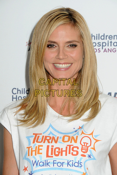 HEIDI KLUM.Children's Hospital Los Angeles 5K Walk held at Griffith Park, Los Angeles, California, USA..April 30th, 2011.headshot portrait white turn on the lights walk for kids t-shirt smiling.CAP/ADM/BP.©Byron Purvis/AdMedia/Capital Pictures.