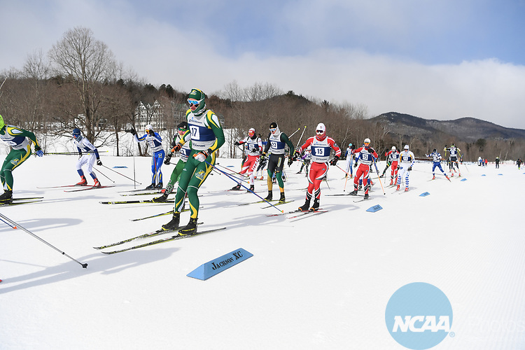 FRANCONIA, NH - MARCH 11:   Athletes leave the start area during the Men's 20K Freestyle event at the Division I Men's and Women's Skiing Championships held at Jackson Ski Touring on March 11, 2017 in Jackson, New Hampshire. (Photo by Gil Talbot/NCAA Photos via Getty Images)