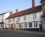 People sitting outside the Crown Hotel,  Framlingham, Suffolk, England