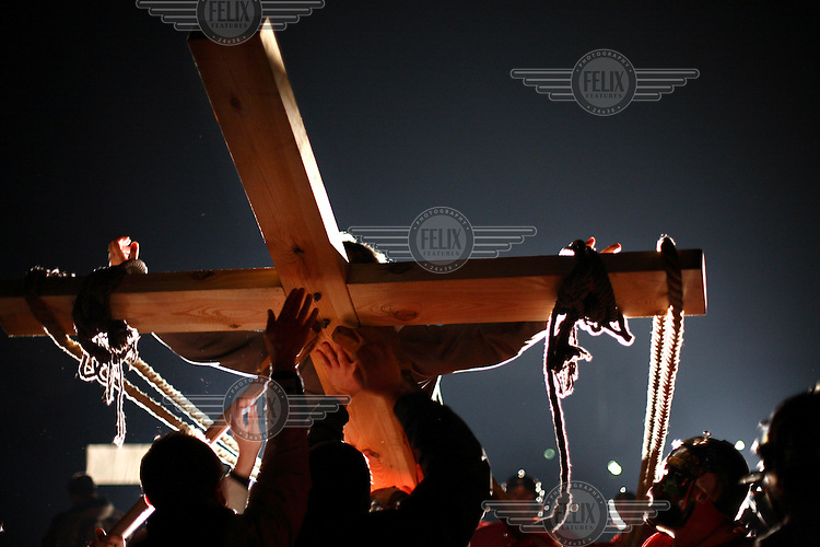 Crucifixion scene in a theatre production of the Passion of Christ. The production, held in the open air at Poznan's citadel, is said to be the largest passion play in Europe with an audience of up to 100,000. Ziemowit Howadek has played Jesus for eleven successive years.