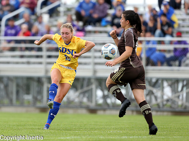 BROOKINGS, SD - AUGUST 13: Marisa Shulz #16 from South Dakota State gets a shot on goal around a defender from Manitoba during the first half of their exhibition match Sunday afternoon at Fishback Soccer Park in Brookings. (Photo by Dave Eggen/Inertia)