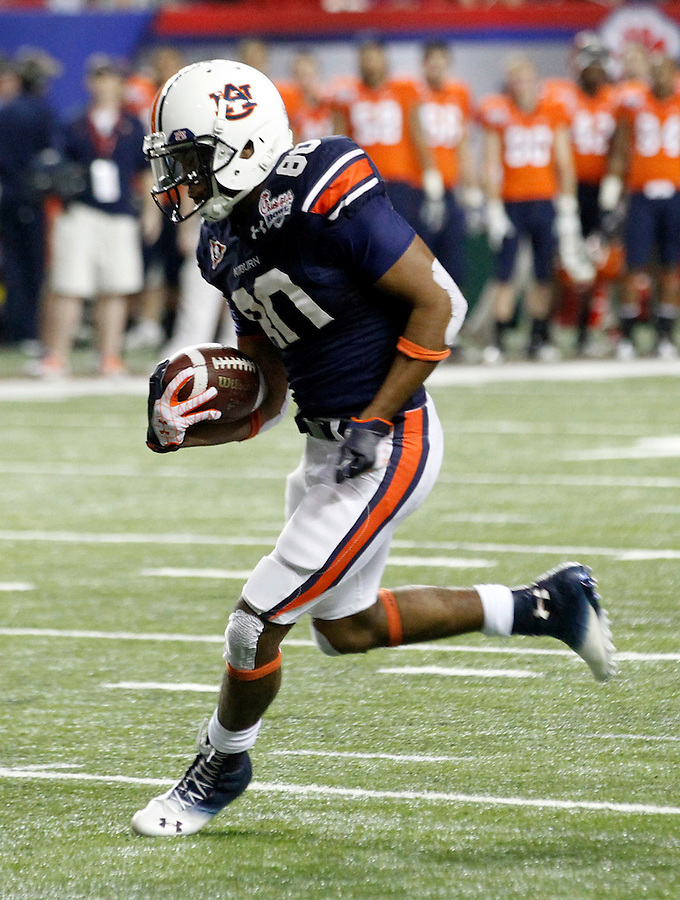 ATLANTA, GA - DECEMBER 31: Emory Blake #80 of the Auburn Tigers runs with the ball during the 2011 Chick Fil-A Bowl against the Virginia Cavaliers at the Georgia Dome on December 31, 2011 in Atlanta, Georgia. Auburn defeated Virginia 43-24. (Photo by Andrew Shurtleff/Getty Images) *** Local Caption *** Emory Blake