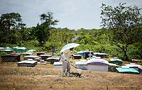 A man cleans up grass around the cemetery in Orinoco, a small Garifuna community north of Pearl Lagoon, Nicaragua in April, 2009.