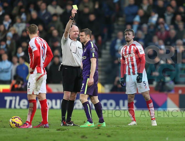 James Milner of Manchester City receives a yellow card - Barclays Premier League - Stoke City vs Manchester City - Britannia Stadium - Stoke on Trent - England - 11th February 2015 - Picture Simon Bellis/Sportimage