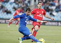 Getafe's Juan Valera (l) and Osasuna's Emiliano Daniel Armenteros during La Liga match.December 15,2012. (ALTERPHOTOS/Acero) /NortePhoto