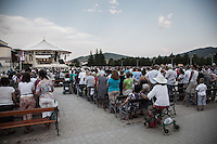 Faithful at the evening mass in Medjugorje.<br /> Medjugorje, Bosnia and Herzegovina. July 2012