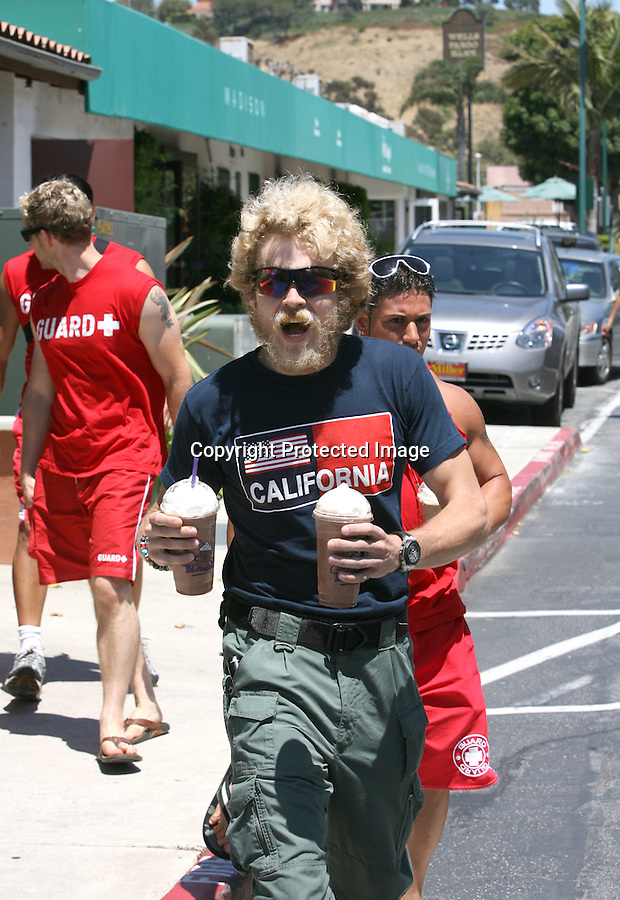 Exclusive    July 14th 2010 ..Malibu California ..Spencer Pratt walking around the cross creek shopping center in malibu with a crazy white beard. Spencer had on some 1980's blue blocker sunglasses. Spencer was walking around with 3 guys dressed in red Guard t-shirts & carrying lifeguard rescue can buoy. They looked like fake lifeguards. Spencer was wearing green military pants holding two cups of coffee from Coffee Bean. Spencer went shopping at a  Rolex watch store & played director while filming with his 3 stooges. ..AbilityFilms@yahoo.com.805-427-3519.www.AbilityFilms.com