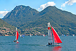 Sailing on Lake Como, Italy with the town of Bellano in the background