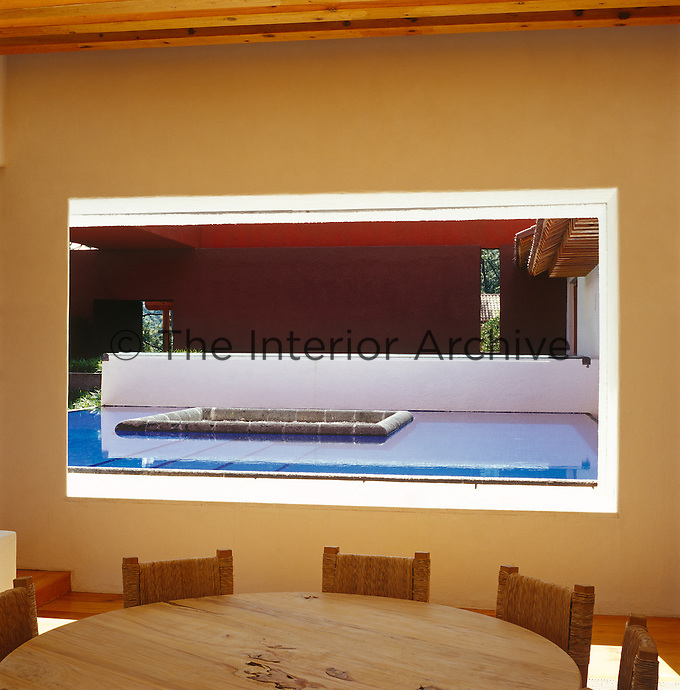 View from the dining area to the swimming pool built into the central courtyard of the house