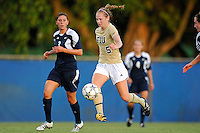27 August 2011:  FIU's Johanna Volz (5) moves the ball upfield while being pursued by Akron's Jordan Clark (3) in the first half as the FIU Golden Panthers defeated the University of Arkon Zips, 1-0, at University Park Stadium in Miami, Florida.
