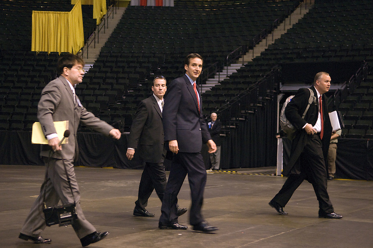 Governor of Minnesota Tim Pawlenty (center)leaves the Xcel Energy Center during the media walk-through for the 2008 RNC Convention in Saint Paul, Minnesota.