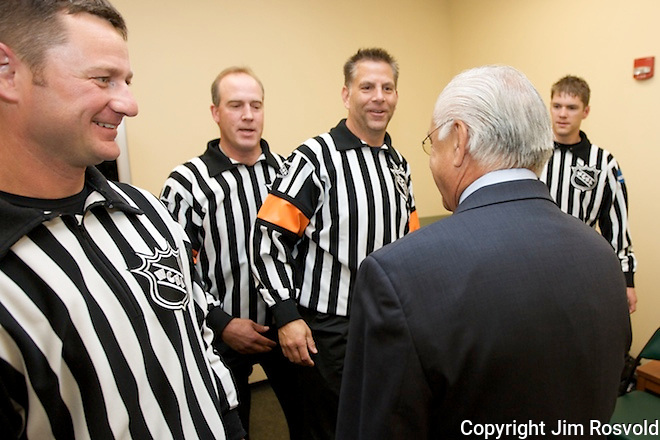 WCHA Commissioner Bruce McLeod pays a visit to the referees before the game.