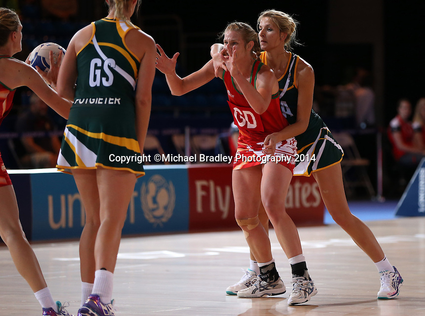 29.07.2014 Wales' Ursula Pritchard and South Africa's Melissa Myburgh in action during the South v Wales netball match at the Commonwealth Games Glasgow Scotland on the 29th of July 2014. Mandatory Photo Credit ©Michael Bradley.