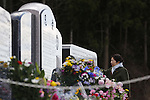 A woman touches a shrine next to Okawa Elementary School on the fifth anniversary of the Great East Japan Earthquake and Tsunami disaster in Ishinomaki on March 11, 2016, Miyagi Prefecture, Japan. Exactly 5 years earlier 74 out of the school's 108 students lost their lives as a result of the tsunami on March 11th, 2011. There are plans to rebuild the school but as yet this has not been fixed. The fate of the destroyed buildings is also expected to be decided soon with residents of the town divided as to whether they should be preserved as a memorial or removed. (Photo by Yusuke Nakanishi/AFLO)