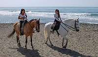 It is nice to be beside the seaside especially when it is beside a warm, sunny Mediterranean - two riders have a canter along the shore near Puerto Banus, 201704233486<br /> <br /> Copyright Image from Victor Patterson, 54 Dorchester Park, <br /> Belfast, UK, BT9 6RJ<br /> <br /> t1: +44 28 9066 1296 (from Rep of Ireland 048 9066 1296)<br /> t2: +44 28 9002 2446 (from Rep of Ireland 048 9002 2446)<br /> m: +44 7802 353836<br /> <br /> e1: victorpatterson@me.com<br /> e2: victorpatterson@gmail.com<br /> <br /> www.victorpatterson.com<br /> <br /> Please see my Terms and Conditions of Use at www.victorpatterson.com. It is IMPORTANT that you familiarise yourself with them.<br /> <br /> Images used on the Internet must be visibly watermarked i.e. © Victor Patterson within the body of the image and copyright metadata must not be deleted. Images used on the Internet have a size restriction of 4kbs and will be chargeable at current NUJ rates unless agreed otherwise.<br /> <br /> This image is only available for the use of the download recipient i.e. television station, newspaper, magazine, book publisher, etc, and must not be passed on to any third party. It is also downloaded on condition that each and every usage is notified within 7 days to victorpatterson@me.com<br /> <br /> The right of Victor Patterson to be identified as the author is asserted in accordance with The Copyright Designs And Patents Act (1988).