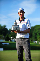 Bethesda, MD - June 29, 2014: Justin Rose poses with the Quicken Loans National trophy after winning the Quicken Loan National at Congressional Country Club in Bethesda MD. The win gives Rose a total of six PGA Tour titles. (Photo by Phillip Peters/Media Images International)