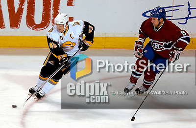 23 October 2006: Buffalo Sabres center, and team captain Daniel Briere (48) maintains puck control against Montreal Canadiens defenseman Mike Komisarek (8) at the Bell Centre in Montreal, Canada on October 23, 2006. The Sabres defeated the Canadiens 4-1. Mandatory photo credit: Ed Wolfstein Photo.<br />  *** Editorial Sales through Icon Sports Media *** www.iconsportsmedia.com