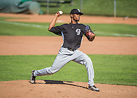 Julian Yan (15) of the Grand Junction Rockies delivers a pitch to the plate against the Ogden Raptors in Pioneer League action at Lindquist Field on July 5, 2015 in Ogden, Utah. Ogden defeated Grand Junction 12-2.  (Stephen Smith/Four Seam Images)