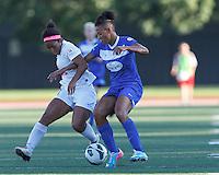 FC Kansas City midfielder Desiree Scott (11) disrupts Boston Breakers forward Lianne Sanderson (10) dribble. In a National Women's Soccer League (NWSL) match, Boston Breakers (blue) defeated FC Kansas City (white), 1-0, at Dilboy Stadium on August 10, 2013.