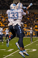 North Carolina wide receivers Josh Cabrera (13) and Juval Mollette (83) appear to be connected at the hip during this touchdown celebration. The North Carolina Tarheels defeated the Pitt Panthers football team 34-31 at Heinz Field, Pittsburgh, Pennsylvania on November 9, 2017.