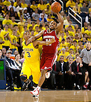 January 8, 2012; Ann Arbor, MI, USA; Wisconsin Badgers guard Jordan Taylor (11) battles for control of the ball with Michigan Wolverines guard Trey Burke (3)  during a Big Ten Conference game at the Crisler Center. (Photo by Bob Campbell)