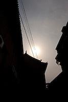 Daytime vertical view of a road running through the siheyuan lined hútòng in the old part of Píngyáo Shì in the Jìnzhōng district in Shānxī Province, China  © LAN