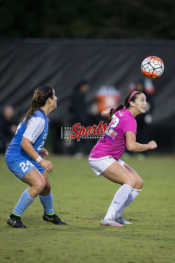 Kendall Fischlein (23) of the Wake Forest Demon Deacons heads the ball away from Paige Nielsen (24) of the North Carolina Tar Heels during second half action at Spry Soccer Stadium on September 27, 2015 in Winston-Salem, North Carolina.  The Tar Heels defeated the Demon Deacons 1-0.  (Brian Westerholt/Sports On Film)