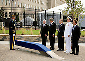 Robert Gates, U.S. Secretary of Defense,  left, U.S. President George W. Bush, second left,  Donald Rumsfeld, former U.S. Secretary of Defense, center, Admiral Michael Mullen, chairman of the Joint Chiefs of Staff, second right and James Laychak, chairman of the board of the Pentagon Memorial Fund watch as a bench is unveiled at the dedication of the September 11th Memorial at the Pentagon on the 7th anniversary of the September 11, 2001 attacks on New York and Washington in Washington, DC, Thursday, September 11, 2008. <br /> Credit: Joshua Roberts / Pool via CNP