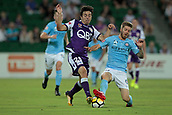 9th January 2018, nib Stadium, Perth, Australia; A League football, Perth Glory versus Melbourne City; Jacob Italiano of the Perth Glory is tackled by Luke Brattan of Melbourne City during the first half