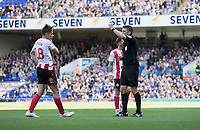 Referee Neil Hair shows a yellow card to George Dobson of Sunderland during Ipswich Town vs Sunderland AFC, Sky Bet EFL League 1 Football at Portman Road on 10th August 2019