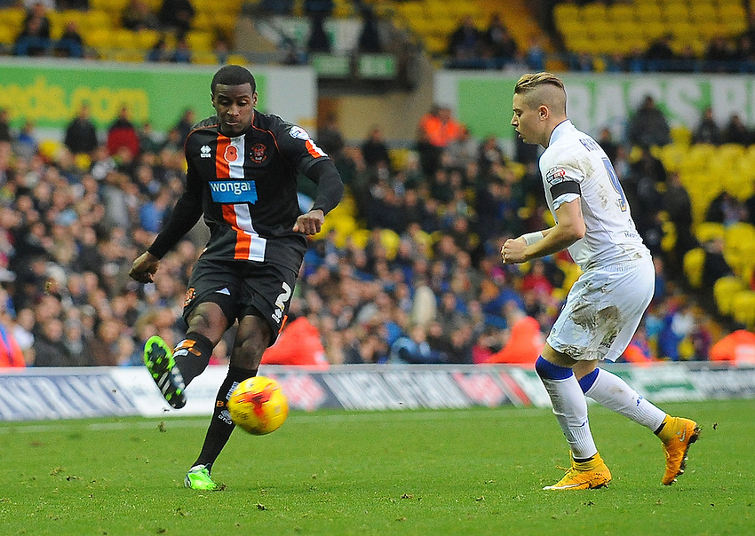 Blackpool's Donervon Daniels under pressure from Leeds United's Adryan<br /> <br /> Photographer Kevin Barnes/CameraSport<br /> <br /> Football - The Football League Sky Bet Championship - Leeds United v Blackpool - Saturday 8th November 2014 - Elland Road - Leeds<br /> <br /> &copy; CameraSport - 43 Linden Ave. Countesthorpe. Leicester. England. LE8 5PG - Tel: +44 (0) 116 277 4147 - admin@camerasport.com - www.camerasport.com