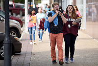 NWA Democrat-Gazette/DAVID GOTTSCHALK Obediah Kimmel (left) and Bella Warner, both seniors from Fayetteville High School, begin to line up their shots Wednesday, October 10, 2019, during day one of the 9th Annual Ozark Media Arts Festival in downtown Springdale. High School students from more than 45 media programs in Arkansas are participating in the two day event that showcases video and photography and offers industry led workshops, onsite competitions, and a network to education and industry.
