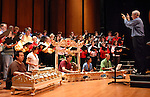 Phillip Kloeckner leads the United Nations Association International Choir during rehearsal at the Hobby Center Sunday April 29,2007.(Dave Rossman/For the Chronicle)