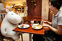 Tokyo, Japan - A woman enjoys breakfast with a huge plush Moomin character at the Moomin House Cafe in TOKYO SKYTREE on June 17, 2014. There are three Moomin Cafe in Japan, serving food and desserts in the form of the Finnish character. This year is the 100th anniversary of the birth of their creator Tove Jansson (1914 - 2001). (C) Moomin CharactersTM. (Photo by Rodrigo Reyes Marin/AFLO)