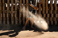 Brian, a ten-year-old Salvadoran boy, throws sand on the ground preparing it for raw bricks at a brick factory in Istahua, El Salvador, 21 December 2013. Child labour is a common practice at the artisanal brick factories, found mainly in rural areas of El Salvador. Poverty and insufficient earnings in agriculture force parents to employ their own children, in an effort to ensure the livelihood for the whole family. Children aged 8-10 are allowed to work slower, with smaller volumes of clay, while children aged 12 and up work regularly, 8-10 hours a day, 6 days a week.