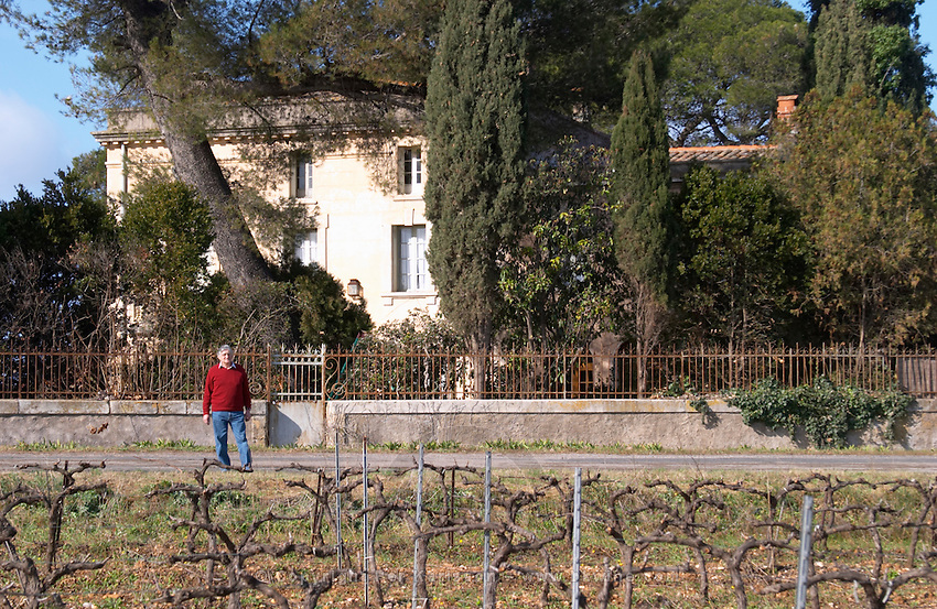 Bernard Jany Chateau la Condamine Bertrand. Pezenas region. Languedoc. Vines trained in Cordon royat pruning. The main building. Owner winemaker. France. Europe. Vineyard.