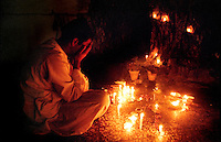 A man prays at a Sufi Shrine in Islamabad in 1996.