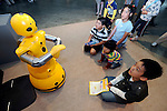 """Young visitors watch Mitsubishi Heavy's Wakamaru talking robot do a dance at Robo Japan 2008 in Yokohama, Japan on Saturday 09 October 2008. Wakamaru stands at  1-meter in height and is equipped with multiple sensors and audio/visual processing functions. Defined as a """"communication robot"""" by MHI, it can have simple conversations with users while looking into their eyes and can even tell the time and play simple games, such as rock, scissors, paper."""