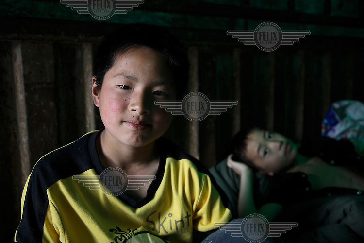 12 year old Li Changjie in a makeshift home inside a truck at the Jiuzhou Stadium in Mianyang. On the 12/05/2008 an earthquake measuring 8.0 on the Richter scale hit the province of Sichuan.