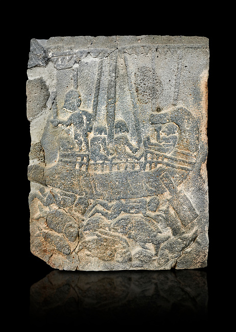 Pictures & images of the North Gate Hittite sculpture stele depicting a ship with fish. 8the century BC.  Karatepe Aslantas Open-Air Museum (Karatepe-Aslantaş Açık Hava Müzesi), Osmaniye Province, Turkey. Against black background