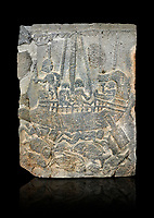 Pictures & images of the North Gate Hittite sculpture stele depicting a ship with fish. 8the century BC.  Karatepe Aslantas Open-Air Museum (Karatepe-Aslantaş Açık Hava Müzesi), Osmaniye Province, Turkey. Against black background