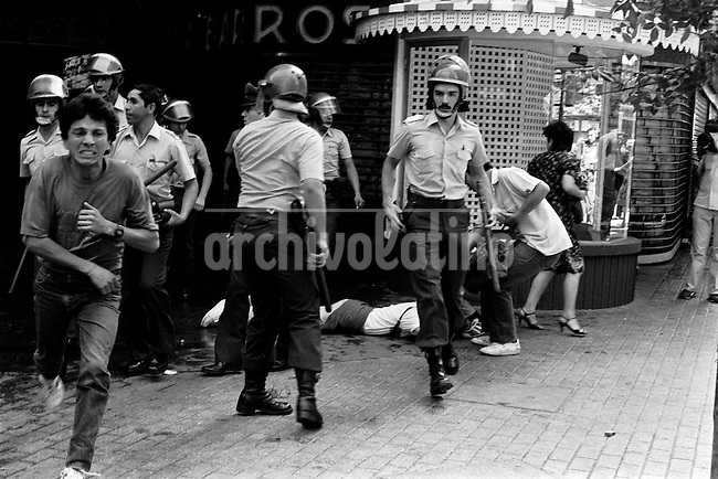 4 Marzo 1984<br /> Jornada de Protesta contra el gobierno en el centro de Santiago Chile, alrededor de 20 personas resultaron detenidas y otras heridas por la polic&radic;&ne;a que reprimi&radic;&ge; las manifestaciones.<br /> <br /> Forty years ago, on September 11, 1973, a military coup led by General Augusto Pinochet toppled the democratic socialist government of Chile. President Salvador Allende was killed during the  attack to seize  La Moneda presidential palace.  In the aftermath of the coup, a quarter of a million people were detained for their political beliefs, 3000 were killed or disappeared and many thousands were tortured.<br /> Some years later in 1981, while Pinochet ruled Chile with iron fist, a young photographer called Juan Carlos Caceres started to freelance in the streets of Santiago and the poblaciones or poor outskirts, showing the growing resistance against the dictatorship. For the next 10 years Caceres photographed every single protest and social movement fighting for the restoration of democracy. He knew that his camera was his only weapon, he knew that his fate was to register the daily violence and leave his images for the History.<br /> In this days Caceres is working to rescue and organize his collection of images in the project Imagenes de la Resistencia   . With support of some Chilean official institutions, thousands of negatives are digitalized and organized to set up the more complete visual heritage of this  violent period of Chile&acute;s history.