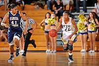 21 January 2012:  FIU guard Jerica Coley (22) breaks to the basket with FAU guard-forward Vontrice Dennis (41) in pursuit in the second half as the Florida Atlantic University Owls defeated the FIU Golden Panthers, 50-49, at the U.S. Century Bank Arena in Miami, Florida.
