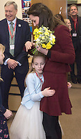 22 February 2017 - Prince Kate Duchess of Cambridge Duchess of gets a hug from Ypapanti Galimatakis during a visit Action for Children projects supporting vulnerable families in Wales. This will be her first engagements with Action for Children since becoming its Patron in December, following on from Her Majesty The Queen. The Duchess visiting Torfaen to see MIST, a child and adolescent mental health project which works specifically with children who are living in care with foster families or birth families. Photo Credit: ALPR/AdMedia
