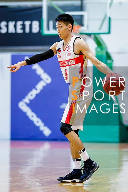 Ng Ka Hin #15 of Nam Ching Basketball Team dribbles the ball up court against the Winling during the Hong Kong Basketball League game between Nam Ching vs Winling at Southorn Stadium on May 11, 2018 in Hong Kong. Photo by Yu Chun Christopher Wong / Power Sport Images