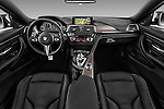 Stock photo of straight dashboard view of 2016 BMW M4 2 Door Coupe Dashboard
