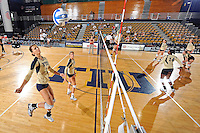 11 September 2011:  FIU's team (Andrea Lakovic (1)) runs through drills prior to the match.  The FIU Golden Panthers defeated the Florida A&M University Rattlers, 3-0 (25-10, 25-23, 26-24), at U.S Century Bank Arena in Miami, Florida.